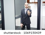 serious airport security in... | Shutterstock . vector #1069150439