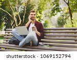 happy casual man with laptop... | Shutterstock . vector #1069152794