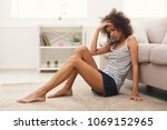 unhappy lonely african american ... | Shutterstock . vector #1069152965