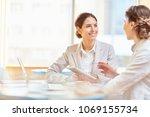 happy businesswoman listening... | Shutterstock . vector #1069155734