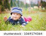 sweet toddler boy in garden ... | Shutterstock . vector #1069174364