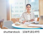young smiling businesswoman in... | Shutterstock . vector #1069181495