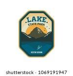 modern shield lake camp badge....   Shutterstock .eps vector #1069191947