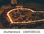 Stock photo heart of candles rose petals 1069200131