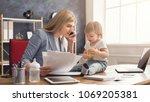 happy beautiful business mom... | Shutterstock . vector #1069205381