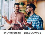 successful male startuppers... | Shutterstock . vector #1069209911