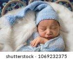 sleeping newborn baby   Shutterstock . vector #1069232375