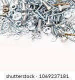 chrome nuts and bolts closeup  | Shutterstock . vector #1069237181