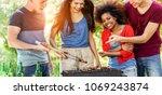group of happy friends cooking... | Shutterstock . vector #1069243874