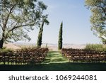 wooden chairs stand on green... | Shutterstock . vector #1069244081