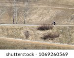 a man ride on bike on the rural ... | Shutterstock . vector #1069260569