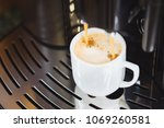 close up of espresso pouring... | Shutterstock . vector #1069260581