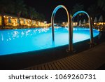 swimming pool at night with... | Shutterstock . vector #1069260731