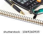 pen  calculator and glasses... | Shutterstock . vector #1069260935
