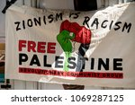 London, United Kingdom, 14th April 2018:- Banner at a gathering of protesters along Kensington High Street, near the Israeli Embassy in London to protest the ongoing occupation of Palestine. - stock photo