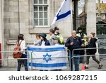 London, United Kingdom, 14th April 2018:- A group of Pro Israel protester opposite a gathering of pro Palestine protesters, near the Israeli Embassy in London. - stock photo