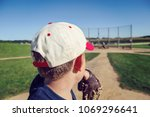 boy pitching a baseball to his... | Shutterstock . vector #1069296641