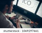 successful investor holding... | Shutterstock . vector #1069297661