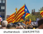 Small photo of Catalan demonstrators with national catalan symbols in Barcelona to support the freedom of the political prisoners.More than 300.000 people have participated. 04. 16. 2018 Spain, Barcelona