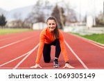athlete woman at starting line | Shutterstock . vector #1069305149