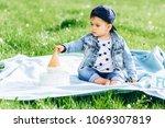 little boy celebrating a... | Shutterstock . vector #1069307819