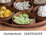 fresh dim sum in bamboo steamer ...   Shutterstock . vector #1069316435