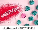 Small photo of Writing note showing Understand Motivational Call. Business photo showcasing Know Perceive the meaning of something written on Illustrated background Crumpled Paper Balls next to it.