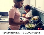 black kid with mom in the... | Shutterstock . vector #1069349045