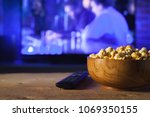a wooden bowl of popcorn and... | Shutterstock . vector #1069350155