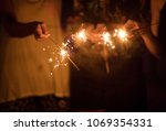 blurred of sparklers with group ... | Shutterstock . vector #1069354331
