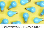 blue painted lightbulbs on a... | Shutterstock . vector #1069361384