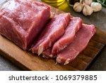 fresh pork raw fillet on wooden ... | Shutterstock . vector #1069379885