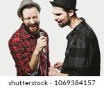two guys singing over white... | Shutterstock . vector #1069384157