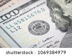 Small photo of Selective focus on US Federal Reserve emblem on hundred dollars banknote as FED consider interest rate hike, economics and inflation control national organization.