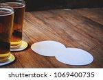 beer in glass on wooden table... | Shutterstock . vector #1069400735
