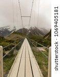 suspension bridge and wooden... | Shutterstock . vector #1069405181