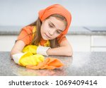 little girl in rubber gloves... | Shutterstock . vector #1069409414