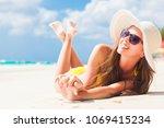 woman in bikini and straw hat... | Shutterstock . vector #1069415234