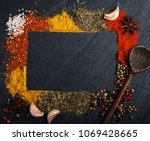different kind of spices on a... | Shutterstock . vector #1069428665