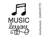 music lessons logo. hand drawn... | Shutterstock .eps vector #1069429775