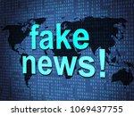 fake news words on digital map...   Shutterstock . vector #1069437755