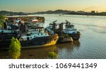 dockyard with tugboats on... | Shutterstock . vector #1069441349
