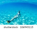 beautiful woman snorkeling in... | Shutterstock . vector #106945115