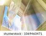 window is open  wind blows ... | Shutterstock . vector #1069463471