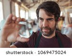 skilled young artisan with a... | Shutterstock . vector #1069475024