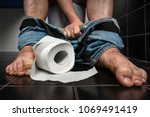 man suffers from diarrhea is... | Shutterstock . vector #1069491419