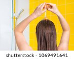 attractive woman applying egg... | Shutterstock . vector #1069491641