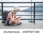 male travelers use mobile look... | Shutterstock . vector #1069507184