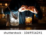 curly guy the barman in a blue... | Shutterstock . vector #1069516241