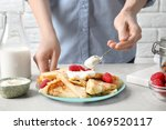 woman adding sour cream to thin ... | Shutterstock . vector #1069520117